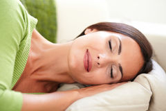 Attractive young woman resting with eyes closed Stock Photo