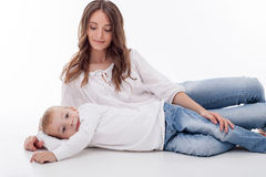 Attractive young woman is resting with her child Stock Images