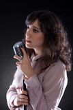 Attractive young  woman with a retro microphone Royalty Free Stock Photo