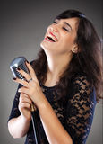 Attractive young  woman with a retro microphone Royalty Free Stock Images