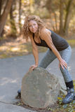 Attractive young woman with a rock Royalty Free Stock Photos