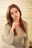 Attractive young woman in room lit by the sun Royalty Free Stock Photo