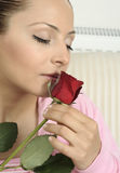Attractive young woman with roses Royalty Free Stock Images