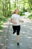Attractive young woman on a run. In nature Royalty Free Stock Images