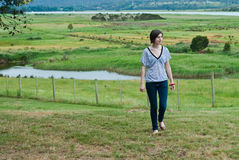Attractive young woman in rural setting Royalty Free Stock Images