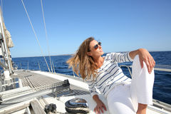Attractive young woman on a sailing cruise Royalty Free Stock Photos