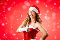 Attractive young woman in Santa Claus costume with thumbs up Stock Images