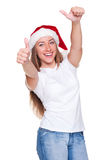 Attractive young woman in santa hat Royalty Free Stock Image