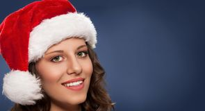 Attractive young woman in Santa hat Stock Photos