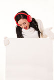 Attractive young woman with santa hat holding white signboard Stock Photography