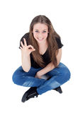 Attractive young woman saying Ok Stock Image