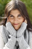 Attractive young woman with scarf and pullover relaxing outdoor Royalty Free Stock Images