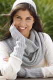 Attractive young woman with scarf and pullover relaxing outdoor Royalty Free Stock Photos