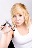 Attractive young woman with scissors Stock Images
