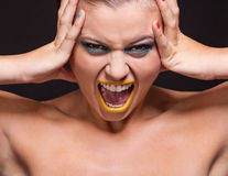 Attractive young woman scream out loud with yellow lipstick Royalty Free Stock Image