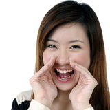 Attractive young woman screaming out loud Stock Image