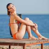 Attractive young woman at the sea Royalty Free Stock Photos