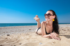 Attractive young woman at the sea Stock Image