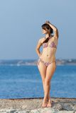 Attractive young woman at the sea Stock Images