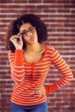 Attractive young woman sending air kiss Stock Photos