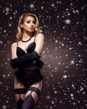 Attractive young woman in sexy lingerie on a snowy background Royalty Free Stock Images