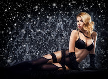 Attractive young woman in sexy lingerie on a snowy background Stock Images