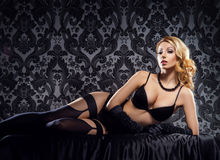 Attractive young woman in lingerie on a vintage background Stock Photo
