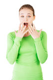 Attractive young woman in a shock. Royalty Free Stock Photo