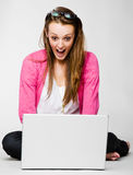 Attractive young woman shocked by her laptop Stock Image