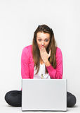 Attractive young woman shocked by her laptop Stock Images