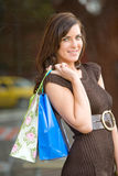 Attractive young woman shopping royalty free stock images