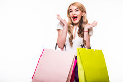 Attractive young woman with shopping bags on white Stock Photos