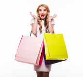 Attractive young woman with shopping bags on white Royalty Free Stock Image