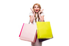 Attractive young woman with shopping bags on white Stock Photography