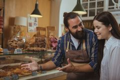 Attractive young woman shopping at bakery store stock images