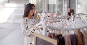 Attractive young woman shopping for clothing Royalty Free Stock Image