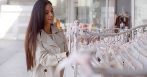 Attractive young woman shopping for clothing Stock Photos