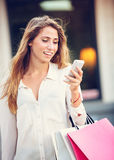 Attractive young woman shopping at the mall Stock Images