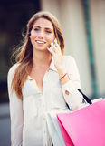 Attractive young woman shopping at the mall royalty free stock photo