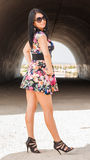 Attractive young woman with short dress with flowers Royalty Free Stock Photography