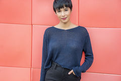 Attractive young woman with short stylish hair friendly smile Stock Photo
