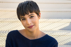 Attractive young woman with short stylish hair friendly smile Royalty Free Stock Photos