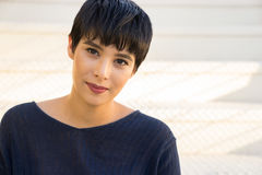 Attractive young woman with short stylish hair friendly smile stock photography