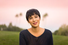 Attractive young woman with short stylish hair friendly smile stock image