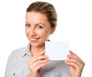 Attractive young woman showing empty blank paper card sign with copy space for text Stock Images