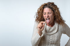 Attractive young woman showing her distaste Royalty Free Stock Photography