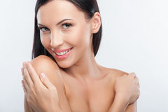 Attractive young woman is showing her perfect body Stock Images