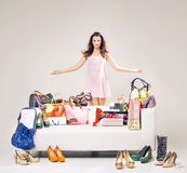 Attractive young woman showing her shopping Royalty Free Stock Photos