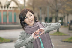 Attractive young woman showing a love shape Stock Image