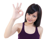 Attractive young woman showing OK sign Royalty Free Stock Photography